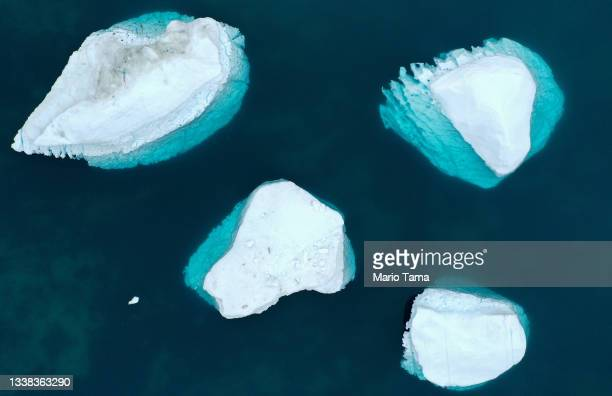 In an aerial view, icebergs which calved from the Sermeq Kujalleq glacier float in the Ilulissat Icefjord on September 04, 2021 in Ilulissat,...