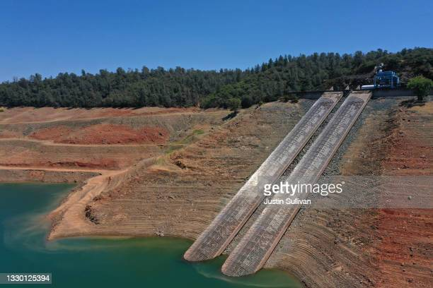 In an aerial view, intake gates are visible at the Edward Hyatt Power Plant intake facility at Lake Oroville on July 22, 2021 in Oroville,...