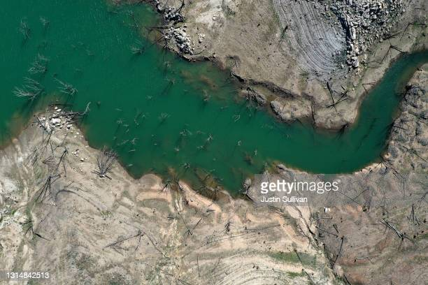 In an aerial view, low water levels are visible at Lake Oroville on April 27, 2021 in Oroville, California. Four years after then California Gov....
