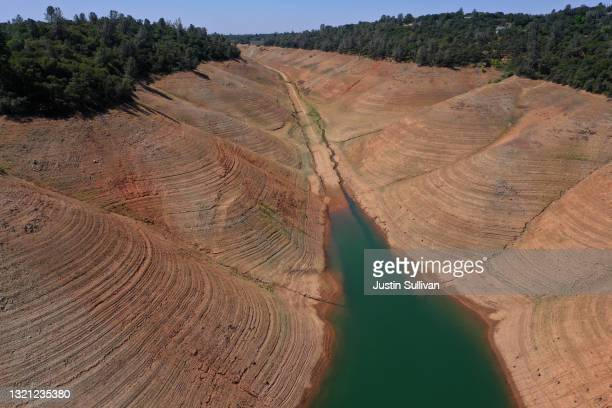 In an aerial view, low water levels are visible at Lake Oroville on June 01, 2021 in Oroville, California. As the extreme drought takes hold in...
