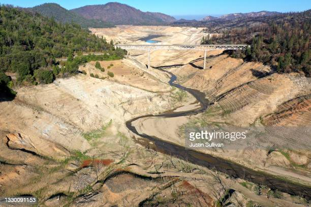 In an aerial view, low water levels are visible at Lake Oroville on July 22, 2021 in Oroville, California. As the extreme drought emergency continues...