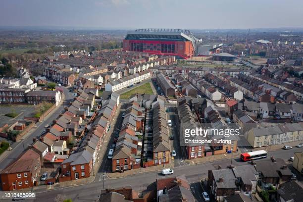 In an aerial view, terraced homes surround Anfield stadium, the home of Liverpool Football Club, after the club disclosed its intentions to join the...