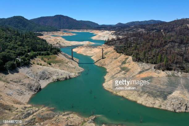 In an aerial view, the Enterprise Bridge crosses over a section of Lake Oroville where water levels are low on April 27, 2021 in Oroville,...