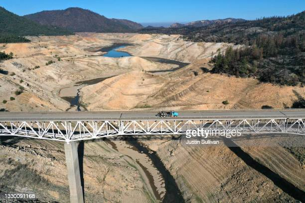 In an aerial view, the Enterprise Bridge crosses over a section of Lake Oroville that was previously underwater on July 22, 2021 in Oroville,...
