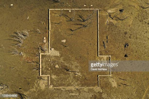 In an aerial view, the foundation of a building that were once submerged is seen on June 14, 2021 near Lake Isabella, California. Authorities are...