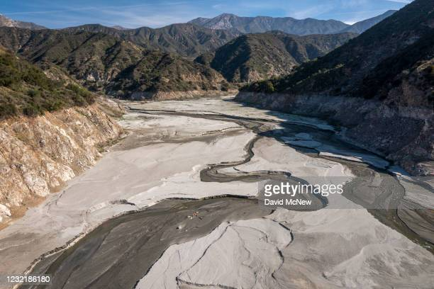 In an aerial view, the San Gabriel River and the exposed lakebed of the San Gabriel Reservoir are seen in the third week of spring as another year of...