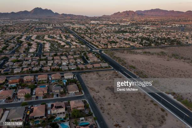 In an aerial view, Urban sprawl spreads across the desert and, increasing water demands as drought continues to worsen on July 1, 2021 in Henderson,...