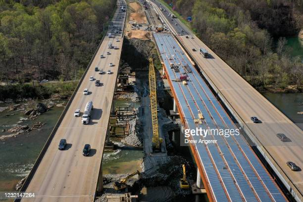 In an aerial view, vehicles on Interstate 95 travel past a construction project to add three lanes to the I-95 Rappahannock River Crossing on April...