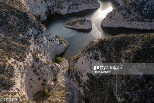 In an aerial view, White Oak Canyon Creek is dried up before reaching Big Tujunga Reservoir, which was not filled to capacity by winter rains, as...