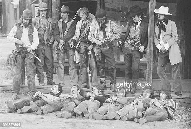 In an alleged reenactment of the capture of the Dalton gang members of the rock band The Eagles play dead during the photo shoot for their album...
