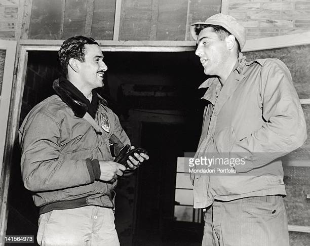In an allied aircraft base in Italy the Brasilian captain aviator Fortunato Camara de Oliveira also famous artist and engraver is talking with the US...