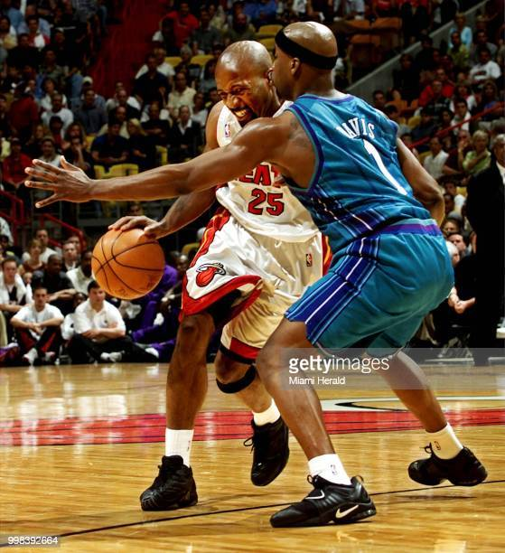 In an April 2001 file image the Miami Heat's Anthony Carter drives against the Charlotte Hornets' Baron Davis right in Miami Carter is spending July...