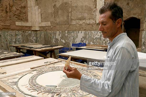 In an archeological study being carried out for 4 years archaeologists try to put together 120000 small pieces of marble excavated within a...