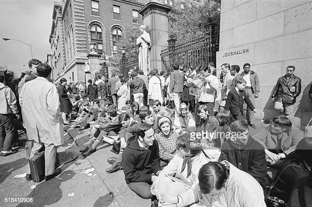 In an attempt to form a human barricade around Columbia University rebel students and sympathizers sit along the perimeter of the campus in New York...