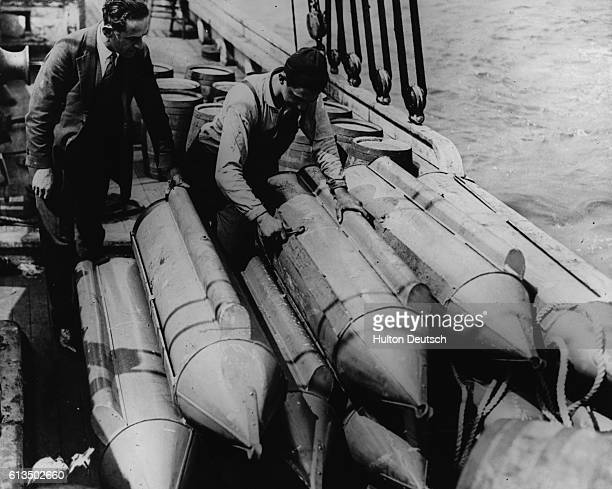 In an attempt to smuggle alcohol during Prohibition, bootleggers have filled torpedoes with malt whiskey. An air compartment has been inserted so...