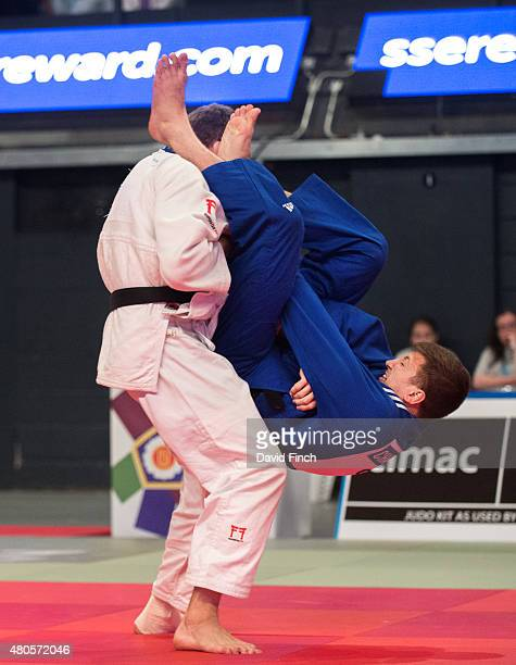 In an audacious move Frazer Chamberlain of Great Britain attempts a leaping armlock on Andrew Burns also of Great Britain during the u90kg final...
