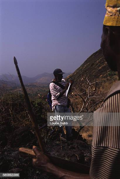 In an effort to learn more about the volcanic rock that characterises the Lake Nyos area Cameroonian geologist Aka Festus Tongwa assisted by local...