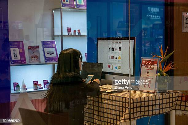 In an experience store a customer is browsing the commodity information on the webpage of TmallHK On Jan11 TmallHK a subbrand of Chinese ecommerce...