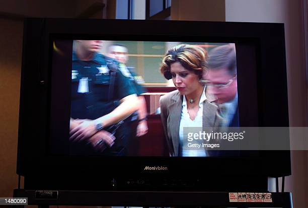 In an image taken from television Noelle Bush leaves an Orange County courtroom in handcuffs October 17 2002 in Orlando Florida Bush the daughter of...