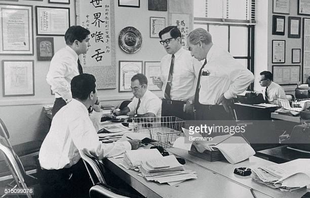 In an improvised newsroom at the New York Times editors work on a pilot issue of a New York afternoon newspaper The paper is being edited by Times...