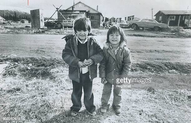 In an Indian village on the outskirts of Whitehorse Darryl Charlie 6 and his cousin Jacky Charlie 5 smile at strangers but the mood in the Yukon is...