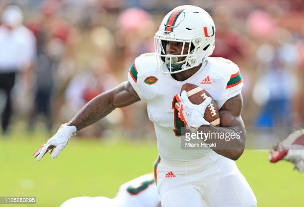 In an October 2017 file image Miami running back Mark Walton carries the ball against Florida State at Doak Campbell Stadium in Tallahassee Fla