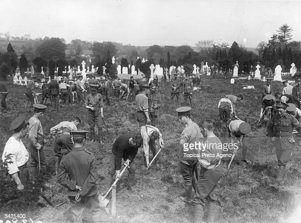 In an old churchyard in Queenstown Ireland soldiers dig graves for the victims of the Lusitania disaster The Lusitania was a Cunard passenger liner...