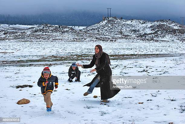 CONTENT] In an unusual Moroccan landscape more Swiss than African three boys throwing snowballs Cold and snow are sweeping the northern regions of...