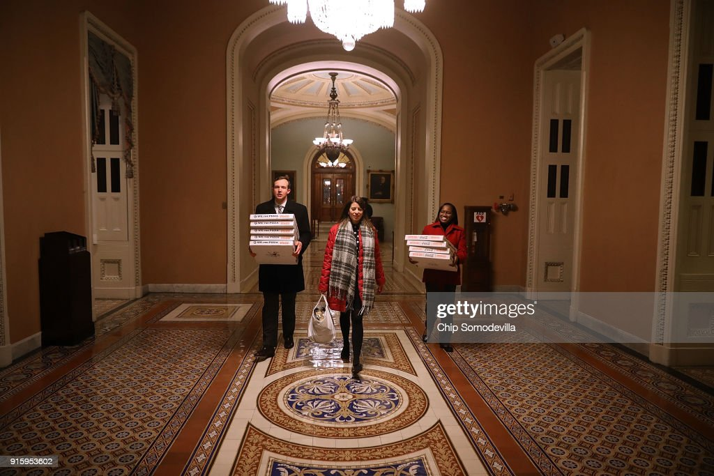 In anticipation of a late night, pizzas are carried to the offices of Senate Majority Leader Mitch McConnel (R-KY) in the U.S. Capitol February 8, 2018 in Washington, DC. Sen. Rand Paul (R-KY), along with a combination of conservative Republicans and liberal Democrats in the House, may sink a budget plan by McConnell and Senate Minority Leader Charles Schumer (D-NY) and precipitate a late-night partial federal government shutdown.