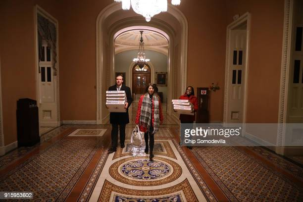 In anticipation of a late night pizzas are carried to the offices of Senate Majority Leader Mitch McConnel in the US Capitol February 8 2018 in...