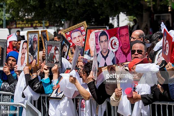 Hundreds of people, martyrs' families and associations, demonstrated in Tunis, from the military tribunal to the National Constituent Assembly in...