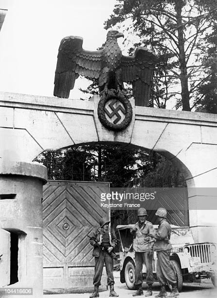 In AprilMay of 1945 three American soldiers are posted in front of the entrance reserved for Nazi dignitaries to the concentration camp at Dachau at...