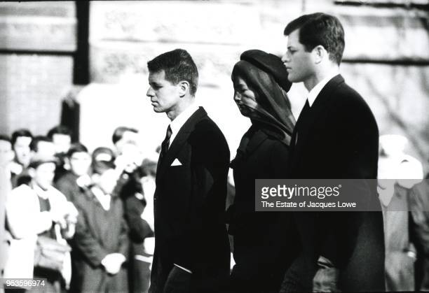 In Arlington National Ceremony Jacqueline Kennedy accompanied by her brothersinlaw US Attorney General Robert F Kennedy and Ted Kennedy attends her...