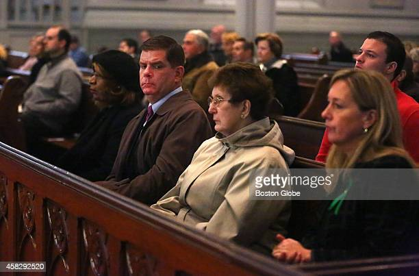 In attendance are Mayor Martin J Walsh his mother Mary Walsh and girlfriend Lorrie Higgins right A memorial Mass for former mayor Thomas M Menino is...