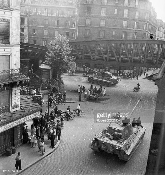 In August 1944 German Tiger II tanks of 503rd Panzer leaving Paris for the Normandy front