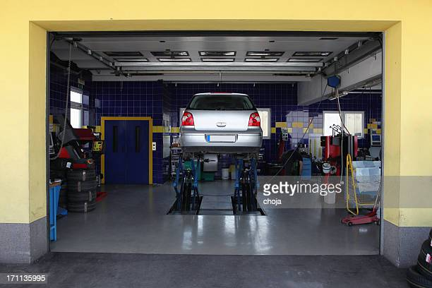 in auto repair shop....changing tires before winter - picking up stock pictures, royalty-free photos & images