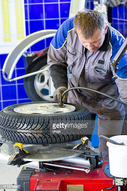 In auto repair shop...Tire air pressure test...changing tire
