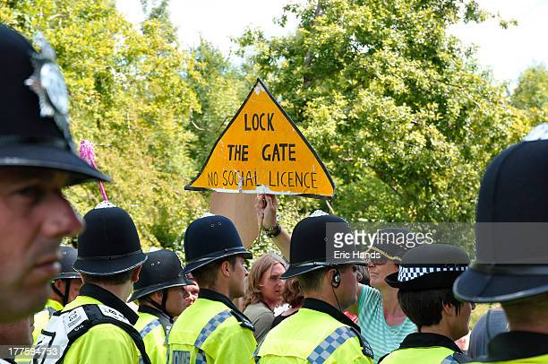 In Balcombe, West Sussex, a police line holds back environmental protestors against drilling by Cuadrilla and the fear that it may lead to fracking.