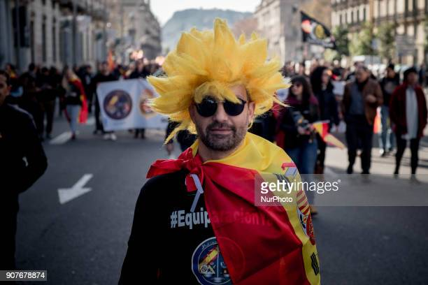 In Barcelona Catalonia Spain a man wrapped with a Spanish flag marches during a protest by police officers on 20 January 2018 Thousands of police...