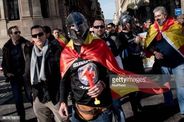 In Barcelona Catalonia Spain a masked man wrapped with a Spanish flag marches during a protest by police officers on 20 January 2018 Thousands of...