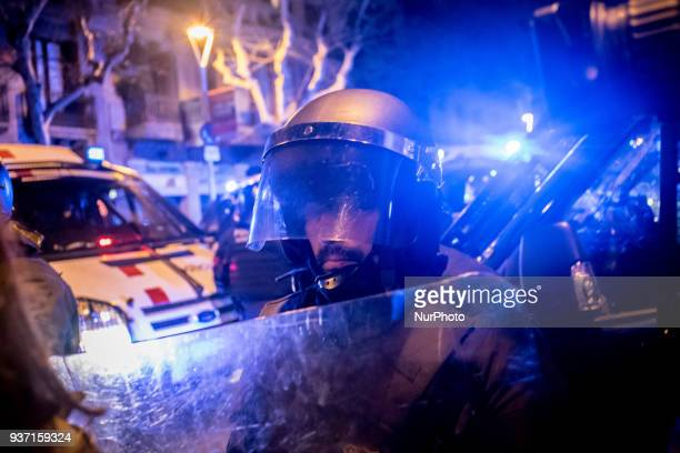 In Barcelona Spain a police officer stands guard close to Spanish government delegation headquarters in Catalonia as thousands go in the streets to...