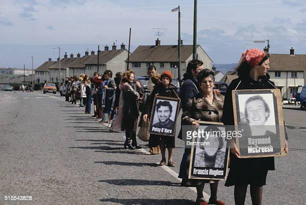 In Belfast Northern Ireland demonstrators carrying portraits hold a silent vigil for the Irish Republican Army hungerstriker Bobby Sands who died in...