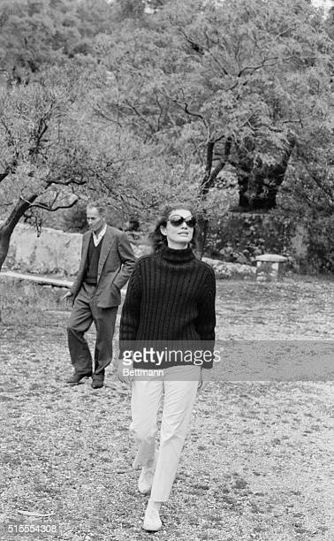 In black sweater and white pants, Jacqueline Onassis tours the island of Maduri, home of the famous Greek poet Valaoritis. Accompanying her is...