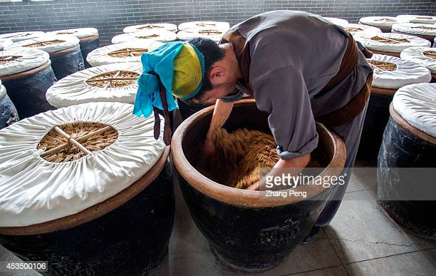 QINGXU TAIYUAN SHANXI CHINA In brewing mass process the worker toss and stir the material twice every day to make sure the material fully absorbs the...