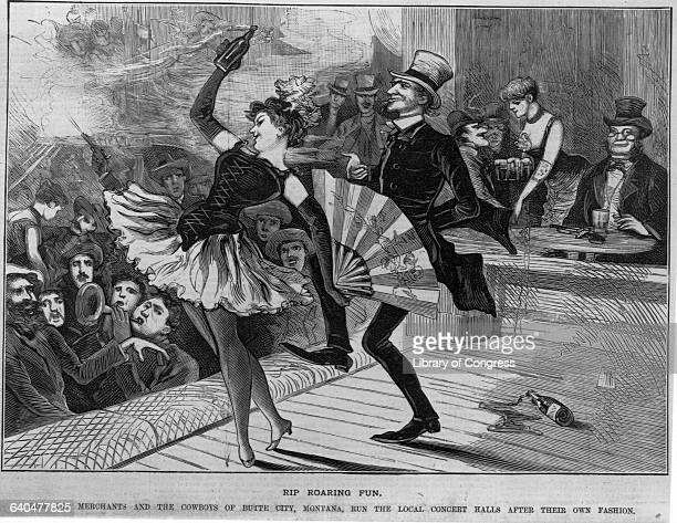 In Butte City Montana a woman dances with a fan while a member of the audience joins in Other men in the audience watch and drink Wood engraving in...