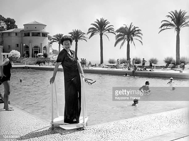 In Cannes on July 24 the French singer REGINE posed near the pool The famous singer spent her vacation at the Palm Beach hotelcasino