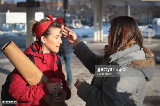 In celebration of Ash Wednesday Xenia Gonzalez of the Urban Village Church rubs ashes on the forehead of a commuter outside of a subway station in...