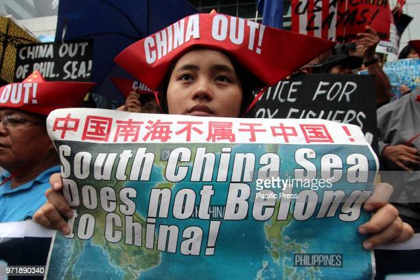 In celebration of the 120th Philippine Independence Day various militants group protest in front of China Embassy in Makati City The groups also...