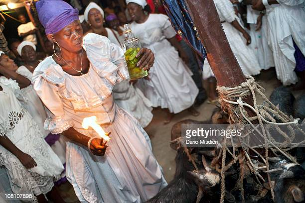 In celebration of the Day of the Dead Haitians participate in a Voodoo ceremony in Petionville PortauPrince on November 2 At the ceremony people...