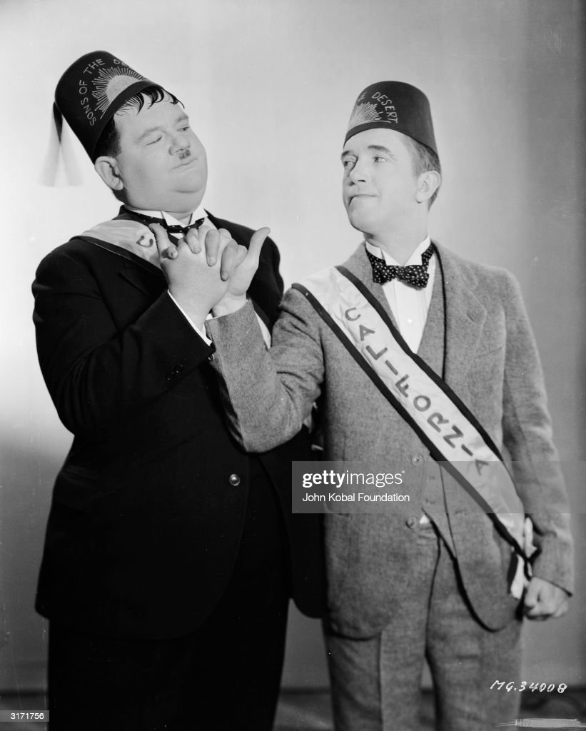 in-ceremonial-fez-and-sash-stan-laurel-a